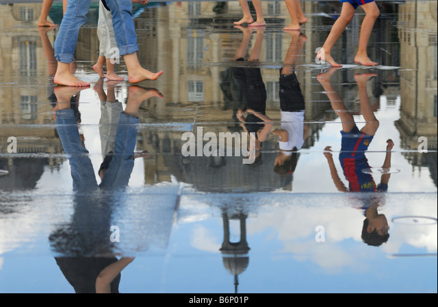Bordeaux France Ornamental water feature on Quai de la Douane and Place de la Bourse in the background - Stock Image