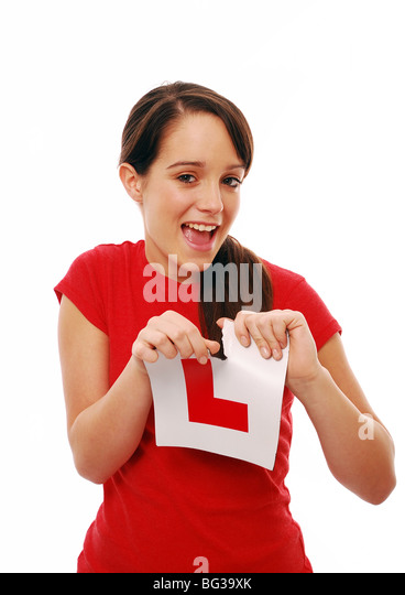 Young girl learner driver ripping up an l plate - Stock Image