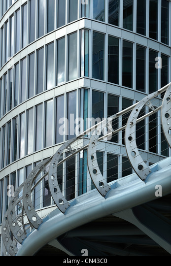 An abstract view of Valentine's Bridge with an office building in the background. Temple Quay, Bristol, UK. - Stock Image