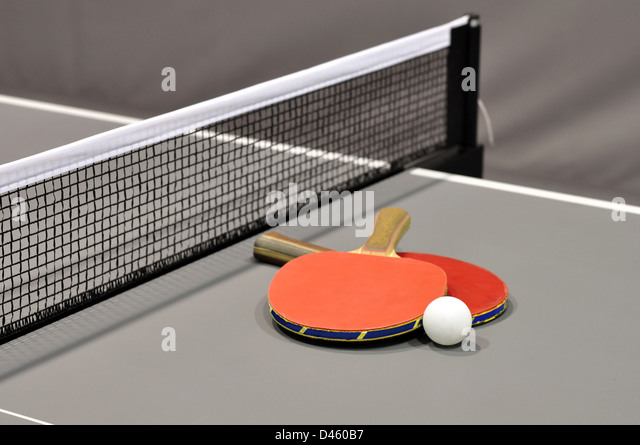 Equipment for table tennis - racket, ball, table closeup. - Stock Image