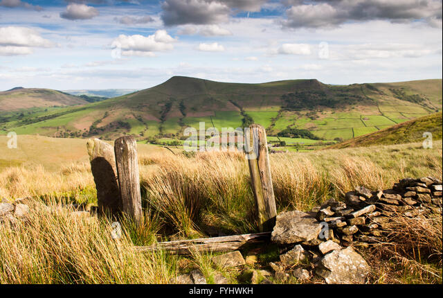 A derelict field boundary wall and gateway on moorland above Edale in the Peak District National Park. - Stock Image