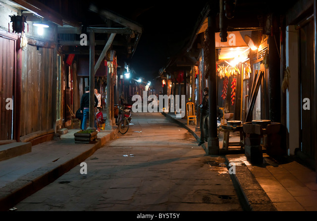 Cobbled street in the ancient town of Huanglongxi in the Sichuan Province of China at night. JMH4373 - Stock Image