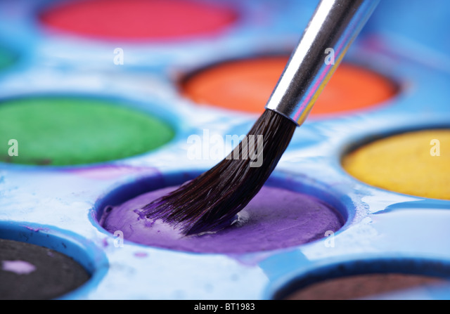 Artist's watercolor palette with brush - Stock-Bilder