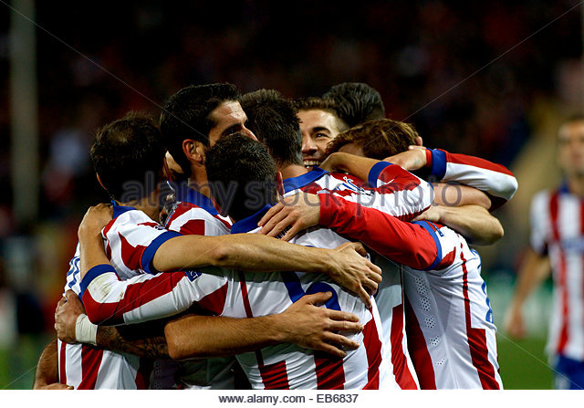Madrid. 26th Nov, 2014. SPAIN, Madrid: Several players of Atletico de Madrid Celebrates a goal during the Champions - Stock Image