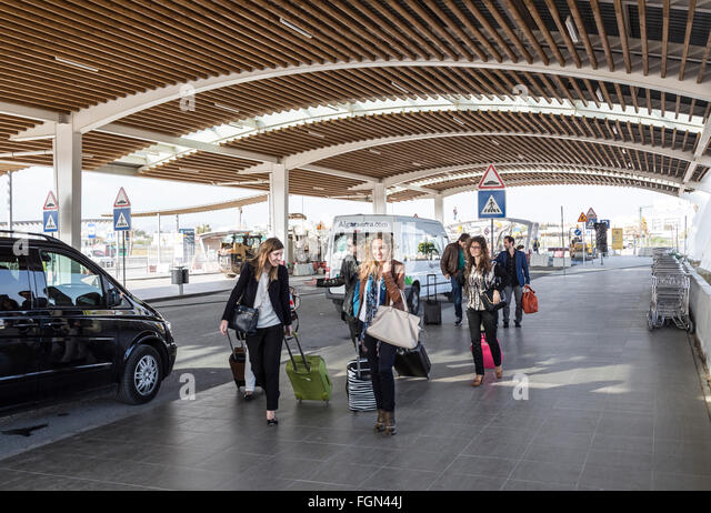 People arriving at Departures at Faro airport, Portugal - Stock Image