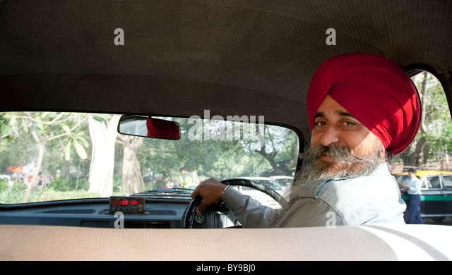 Portrait of a Sikh taxi driver - Stock Image