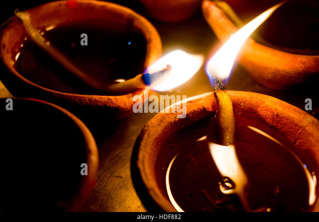 Earthen ware pots with cotton and oil to light - Stock Image