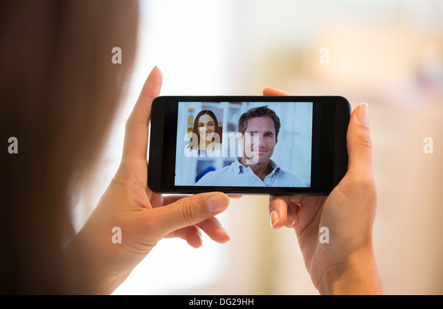 Woman chatting with her friend on smartphone - Stock-Bilder