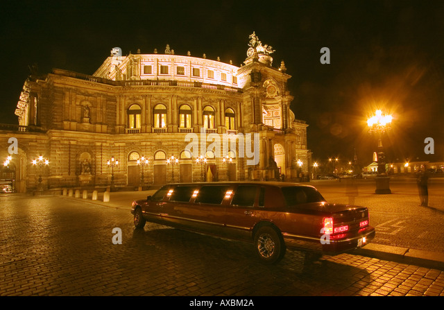 DEU Dresden Saxony Semper Opera house strecht limousine at night - Stock Image