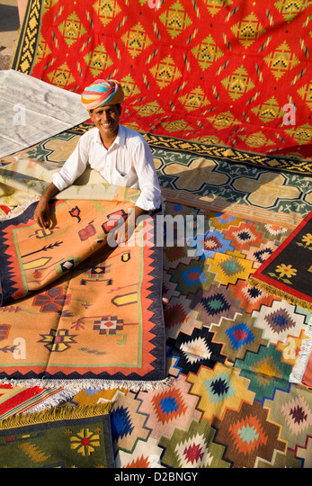 Rug Designer Shows Off His Hand-Made Carpets In Village Outside Jodhpur Rajasthan India - Stock Image