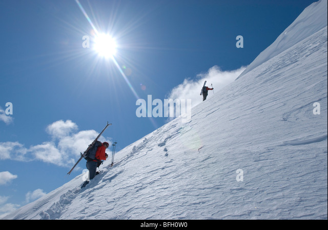 Heading along the ridge of an unnamed summit Marriot Basin area Coast Mountains BC Canada - Stock Image