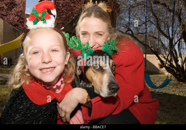 A mother and daughter and a dog - Stock-Bilder