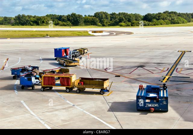 Baggage vehicles on an airport runway, Tampa, Florida. - Stock-Bilder