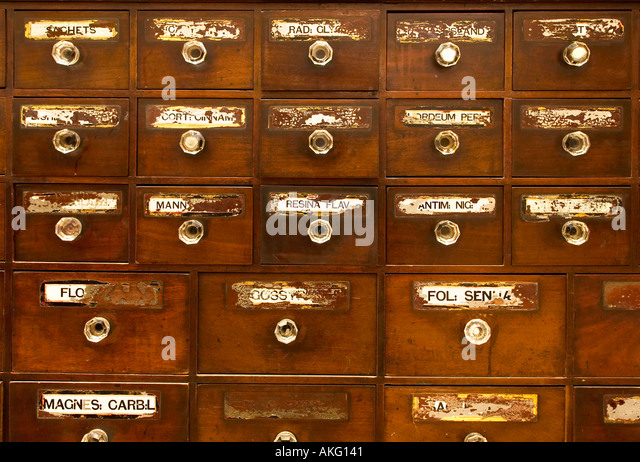 Antique apothecary drawers UK - Stock Image
