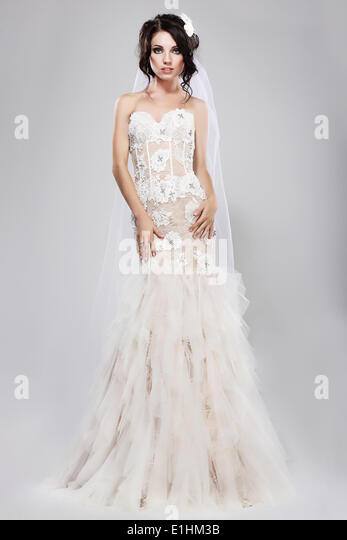 Espousal. Genuine Gorgeous Bride in Long White Bridal Dress. Wedding Style - Stock Image