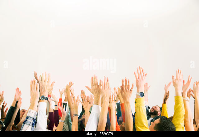 Business people with arms raised - Stock Image