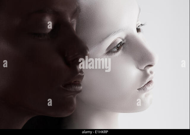 Cultural Diversity. Two Faces Colored Black & White. Yin Yang Style - Stock Image