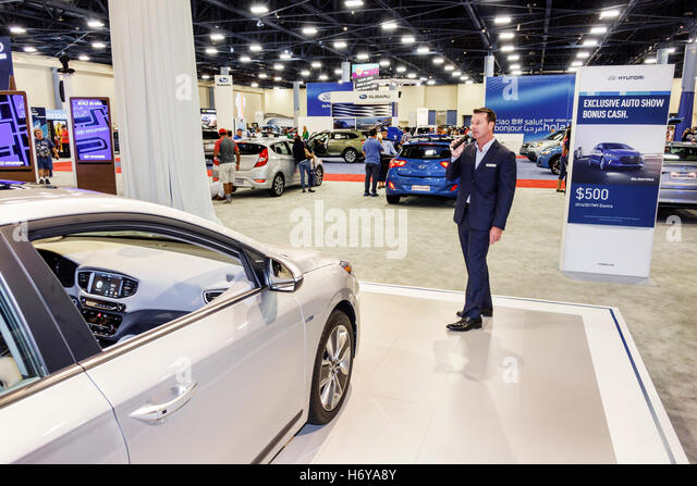 Florida Miami Beach Convention Center centre interior International Auto Show new models man speaker speaking microphone - Stock Image
