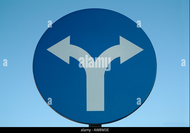 Road Traffic Sign Showing Left and Right Turning Ahead Only, Close Up. - Stock Image