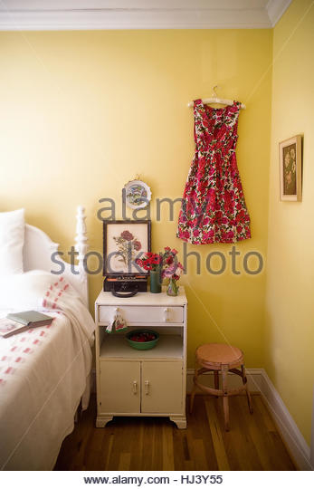 Yellow Bedroom with Dress - Stock Image