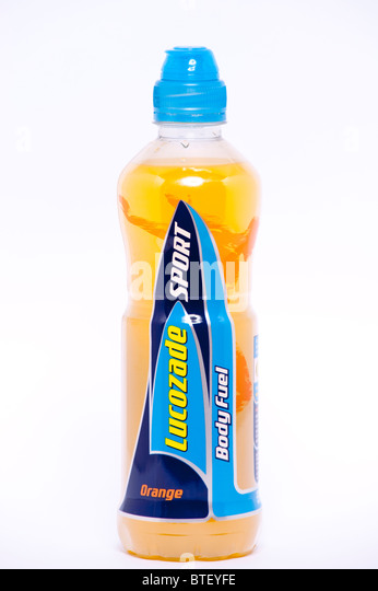 A close up photo of a bottle of Lucozade Sport orange flavour energy drink against a white background - Stock Image