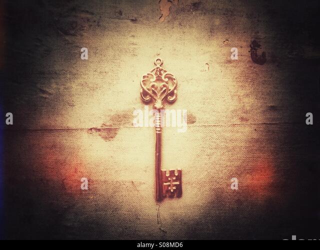 Golden ornate key - Stock Image