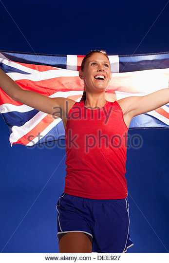 Athlete carrying Union Jack flag - Stock Image