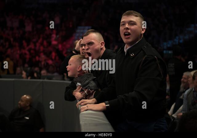 U.S. soldiers in the crowd cheer on WWE performers during a wrestling match for the 14th Annual Tribute to the Troops - Stock Image