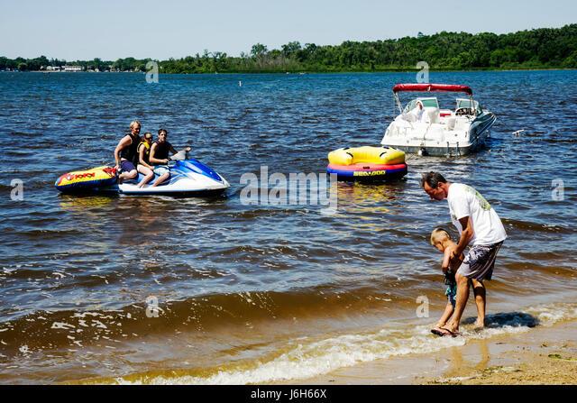 Wisconsin Kenosha Silver Lake Silver Lake Park man men woman boy personal watercraft boat jet ski water sport father - Stock Image