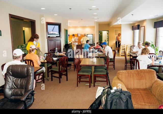 Wisconsin Kenosha Holiday Inn Express hotel motel lodging breakfast room budget man men woman women boy family eat - Stock Image
