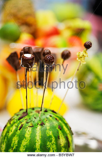 chocolate-covered fruits and marshmallows - Stock Image
