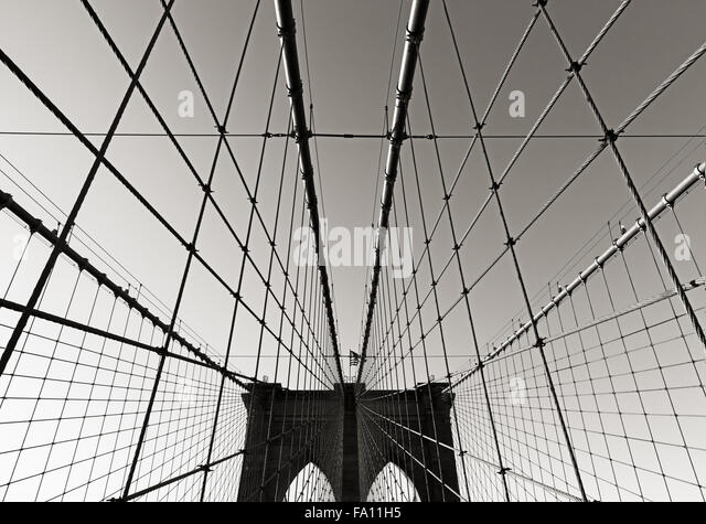 Brooklyn Bridge tower, in Black & White, with double gothic arches and symmetrical suspension cables, New York - Stock Image