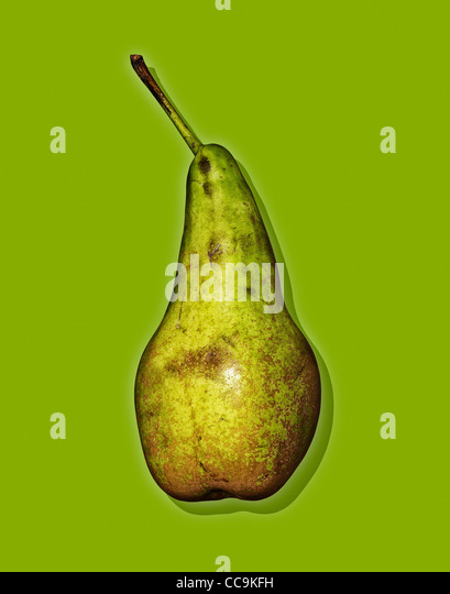 Pear against a green background - Stock Image