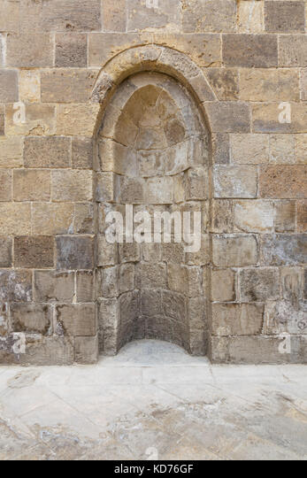 Stone wall with embedded niche, Exterior wall of Mausoleum of al-Salih Nagm Ad-Din Ayyub, Cairo, Egypt - Stock Image