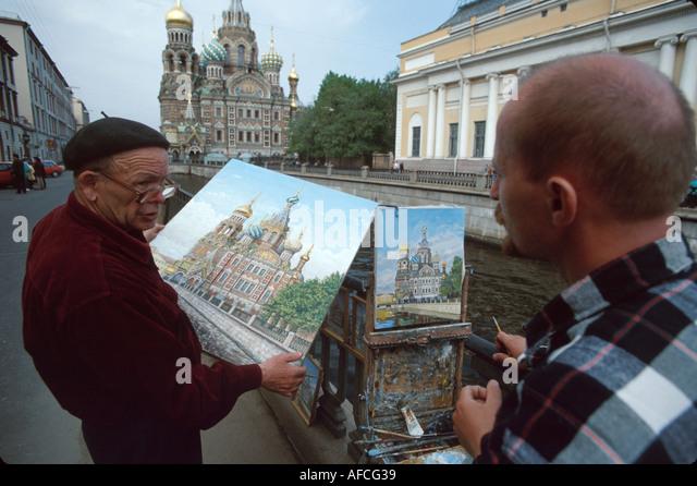 Russia former Soviet Union St. Petersburg artists compare paintings Church on Savior's Blood Czar Alexander - Stock Image
