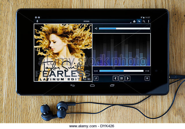 Taylor Swift Fearless MP3 album art on PC tablet, England - Stock Image