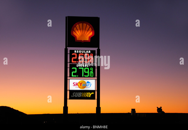 Gas Station dawn early morning price board board Shell gas sky Grants New Mexico USA America North America - Stock Image