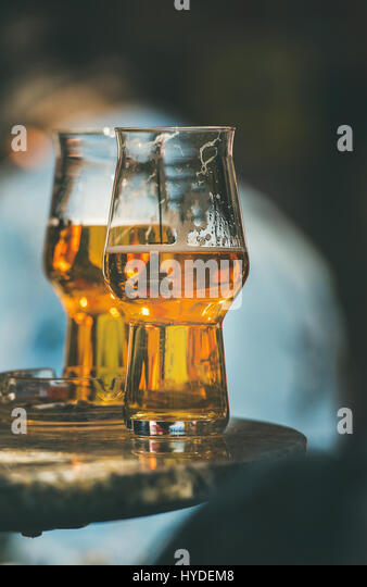 Two glasses of beer on a table in street cafe - Stock Image