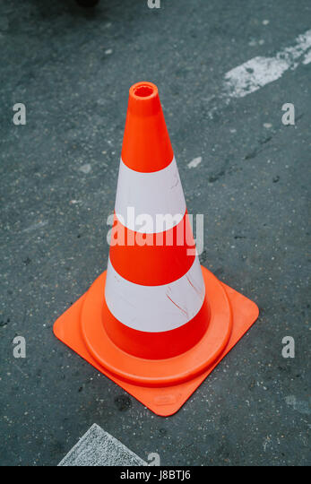 Traffic cone on the road - Stock Image