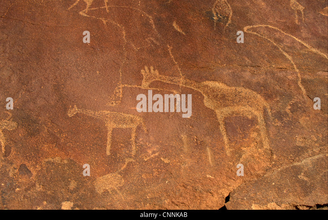 Archaeology Petroglyphs. Bushman Rock Paintings at Twyfelfontain, Namibia - Stock Image