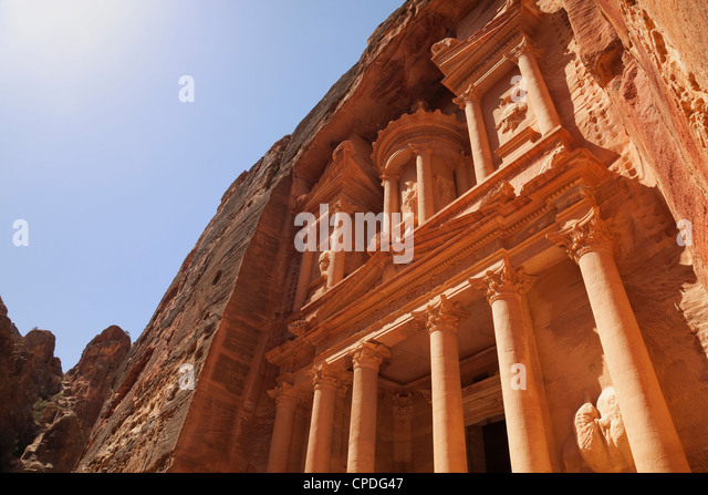 The facade of the Treasury (Al Khazneh) carved into the red rock at Petra, UNESCO World Heritage Site, Jordan, Middle - Stock Image