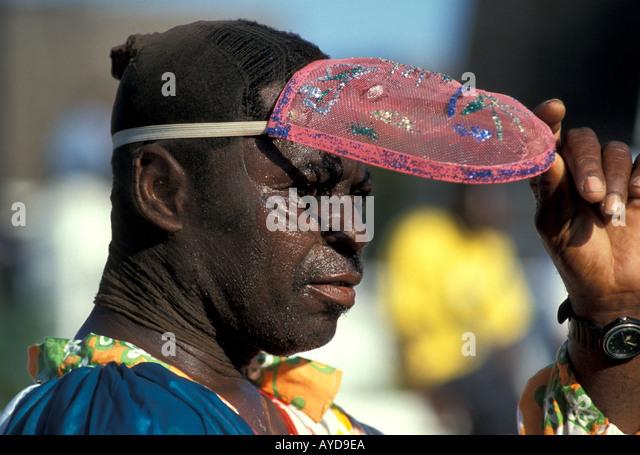 St Maarten Caribbean Carnival Man lifting face mask - Stock Image