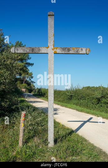 Concrete roadside cross, Chambon, France. - Stock Image