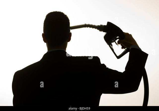 man holding a gas pump to his head - Stock Image