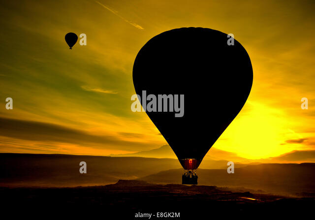 Silhouette of hot air balloon at sunset, Avanos, Cappadocia, Turkey - Stock Image
