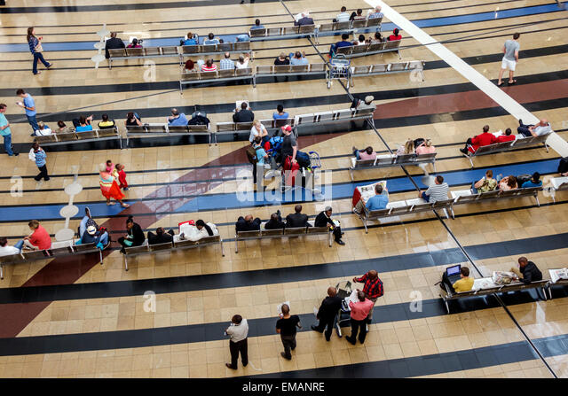 Johannesburg South Africa African O. R. Tambo International Airport terminal concourse gate area passengers overhead - Stock Image