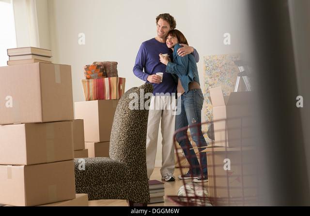 Couple having a drink break whilst moving - Stock-Bilder