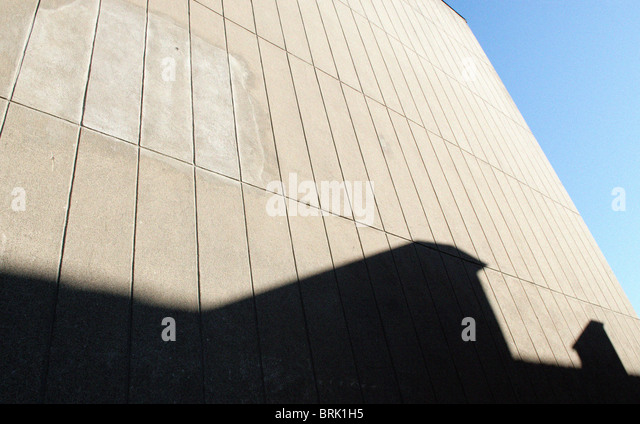 TALL WALL WITH SHADOW - Stock Image