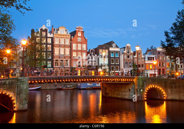 Europe, Netherlands, Amsterdam, Canal at Dusk - Stock Image