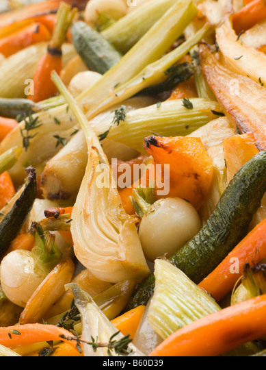 Honey and Thyme Roasted Baby Vegetables - Stock Image